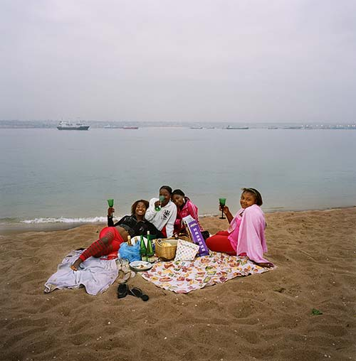 Angola, Luanda,  Teenage girls drink wine on the beach at Ilha de Luanda as they celebrate a friend's birthday. © Alfredo D'Amato / Panos Pictures