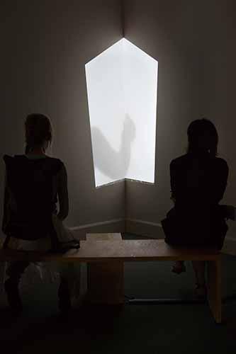 """© Bruna Esposito. """"La Bacchetta Magica"""", 2015. Video proiezione 8' b/n e colore, panca, angolo. Courtesy: l'artista"""