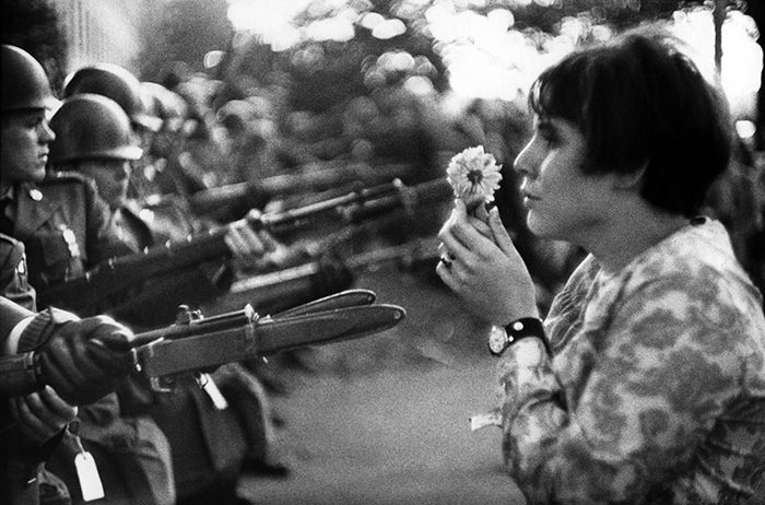 ©Marc Riboud. Washington, D.C., 1967.  During a march on the Pentagon on October 21, 1967, to protest the war in Vietnam, Jan Rose Kasmir presented a wonderful picture of peace-loving American youth.