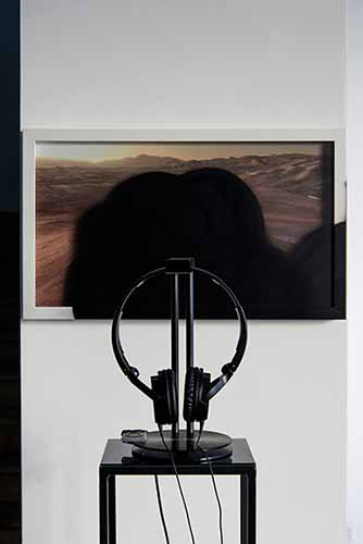 Marco Strappato. Over Painted ESO#4, 2015. C-type, spray paint, 31x52cm and Mondi Lontanissimi by Franco Battiato (1985). Headphones, headphone stand, iPod shuffle, lacobel, iron. Courtesy The Gallery Apart, Rome. Photo by Giorgio Benni
