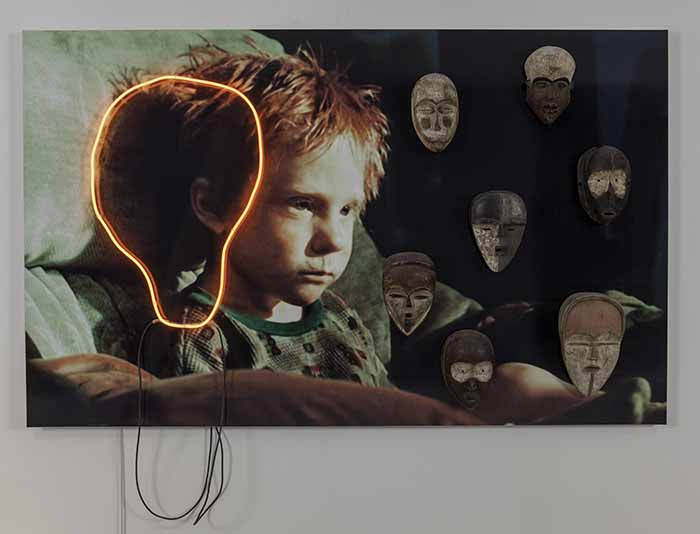 © Sarkis. On the Breaking Bad's wallpaper between the Cry and the Masks, 2014. Photograph mounted on aluminium, neon, 6 african masks 144 x 235 cm. Courtesy Sarkis & Galerie Nathalie Obadia Paris/Bruxelles  Photo: We Document Art